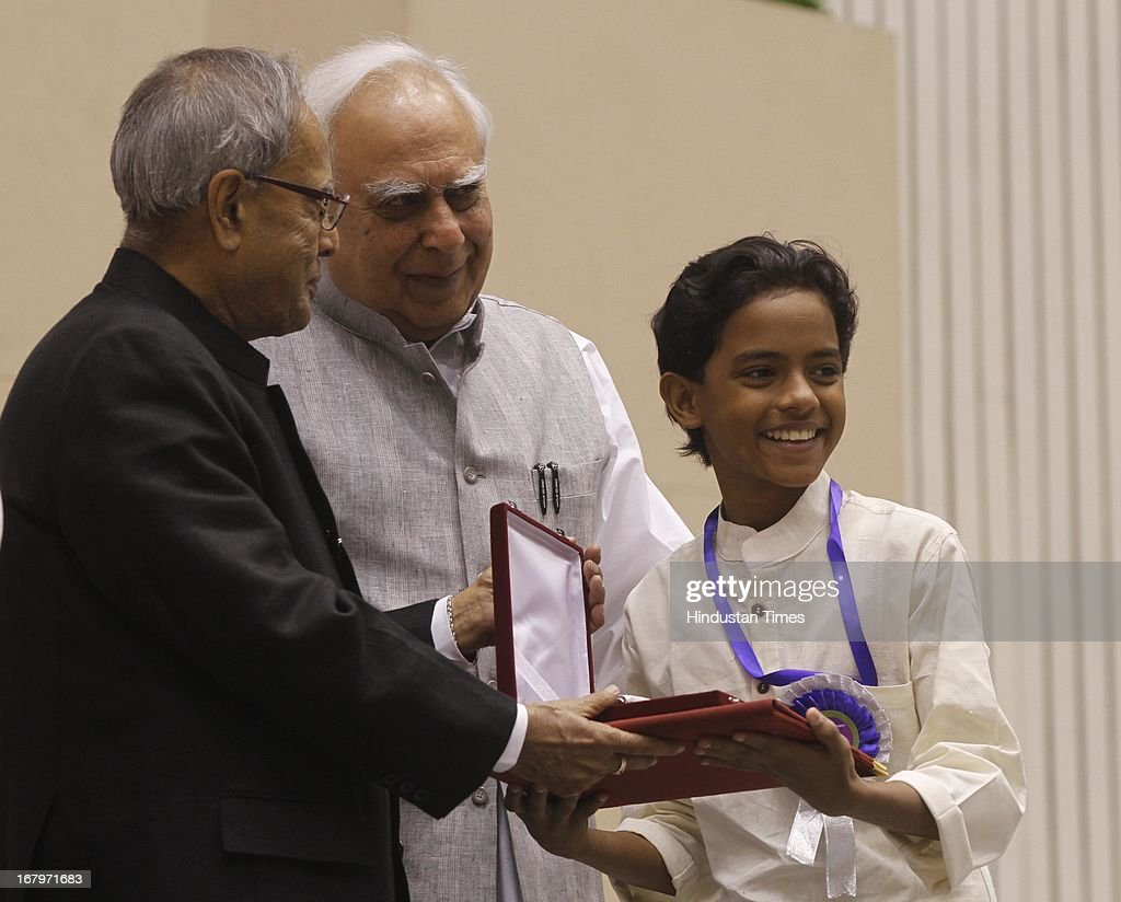 President Pranab Mukherjee presenting best child artist award to Minon for his performance in 101 Chodiyangal during 60th National Film Awards on May 03, 2013 in New Delhi , India. Paan Singh Tomar' got best film award and its lead actor Irrfan Khan adjudged as the best actor.