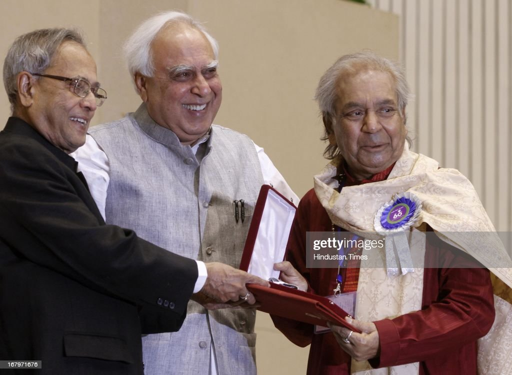 President Pranab Mukherjee presenting best Choreography award to Pandit Birju Maharaj for film Vishwaroopam during 60th National Film Awards on May 03, 2013 in New Delhi , India. Paan Singh Tomar' got best film award and its lead actor Irrfan Khan adjudged as the best actor.