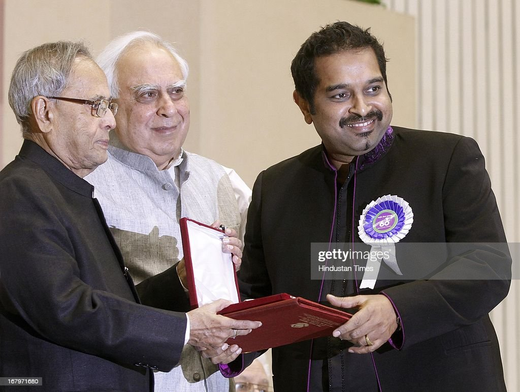 President Pranab Mukherjee presenting best singer award to Shankar Mahadevan during 60th National Film Awards on May 03, 2013 in New Delhi , India. Paan Singh Tomar' got best film award and its lead actor Irrfan Khan adjudged as the best actor.
