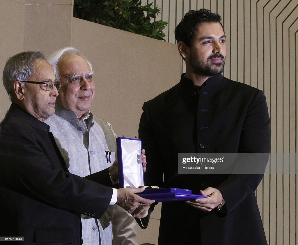 President Pranab Mukherjee presenting John Abraham best film providing wholesome entertainment for his film Vicky Donor at 60th National Film Awards on May 03, 2013 in New Delhi , India. Paan Singh Tomar' got best film award and its lead actor Irrfan Khan adjudged as the best actor.