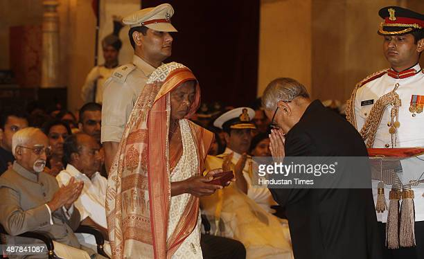 President Pranab Mukherjee presenting Kirti Chakra to Sushila Choudhary mother of Late COBRA Commando Bhrigu Nandan Choudhary during the Defence...