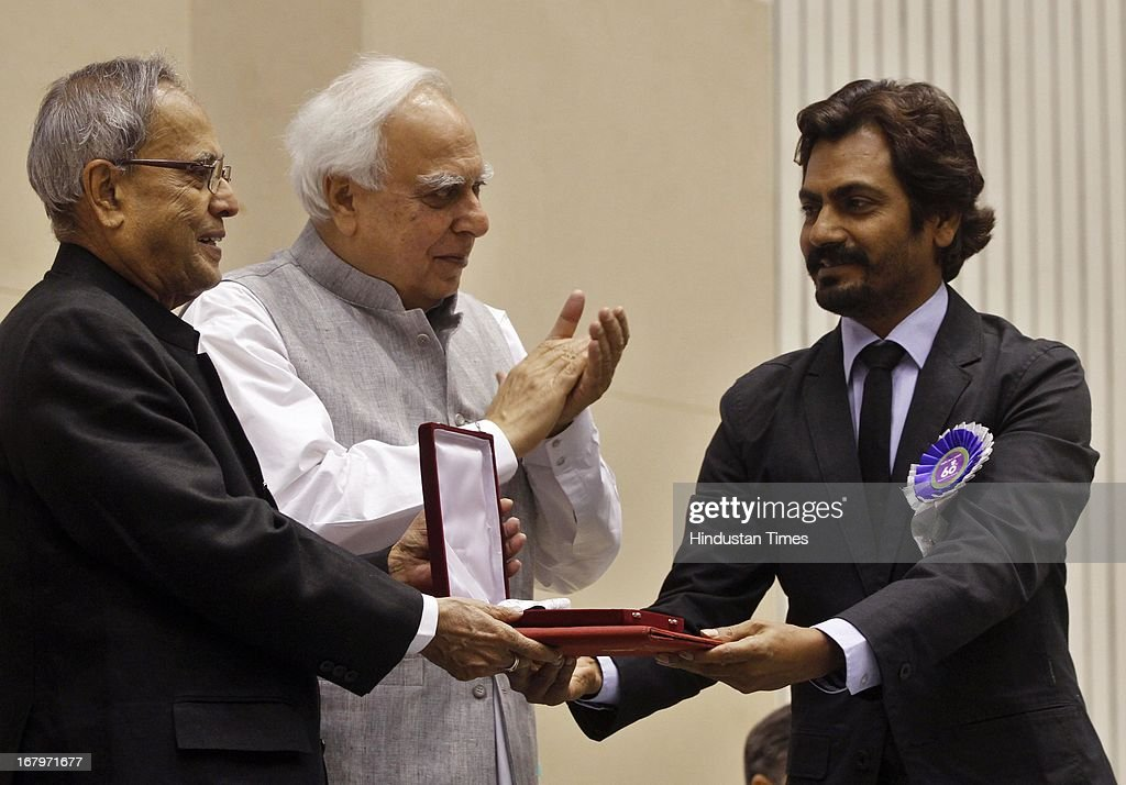 President Pranab Mukherjee presenting Special Jury award (shared) to Nawazuddin Siddiqui during 60th National Film Awards on May 03, 2013 in New Delhi , India. Paan Singh Tomar' got best film award and its lead actor Irrfan Khan adjudged as the best actor.