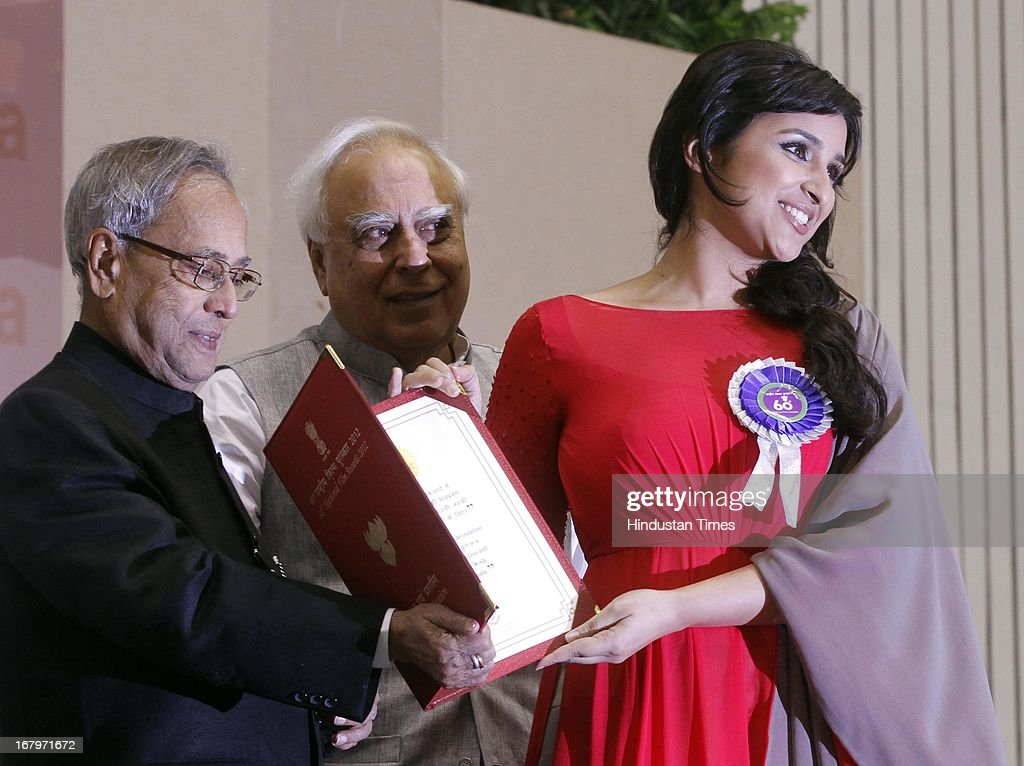 President Pranab Mukherjee presenting Special Mention award to actress Parineeti Chopra during 60th National Film Awards on May 03, 2013 in New Delhi , India. Paan Singh Tomar' got best film award and its lead actor Irrfan Khan adjudged as the best actor.