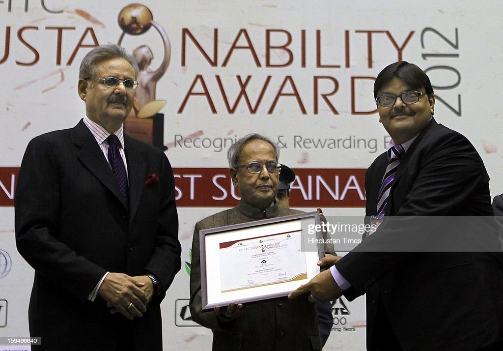 President Pranab Mukherjee presenting the Sustainability Awards 2012 to CS Verma, Chairman Steel Authority of India Limited, as YC Deveshwar looks on at Vigyan Bhawan on January 14, 2013 in New Delhi, India.