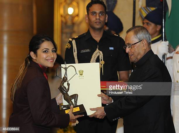 President Pranab Mukherjee presents Arjuna Award 2014 to shooter Heena Sidhu at the National Sports and Adventure Awards function on August 29 2014...