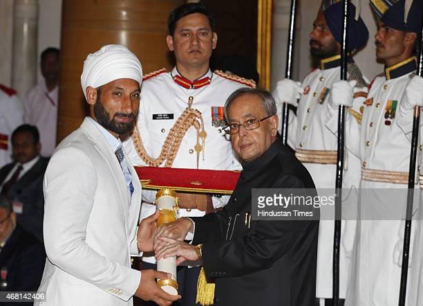 President Pranab Mukherjee presents Padma Shri award to Indian mens hockey team captain Sardar Singh during a Civil Investiture Ceremony at...