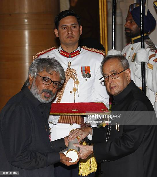 President Pranab Mukherjee presents Padma Shri award to Sanjay Leela Bhansali during a Civil Investiture Ceremony at Rashtrapati Bhavan on March 30...