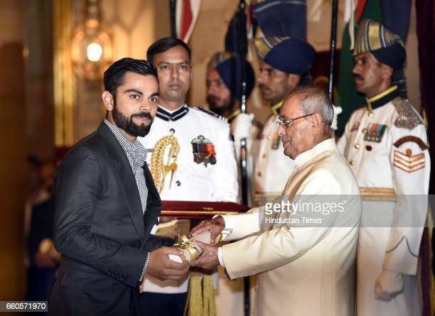 President Pranab Mukherjee presents the Padma Shri Award 2017 to Virat Kohli during the Padma Awards 2017 ceremony at Rashtrapati Bhavan on March 30...