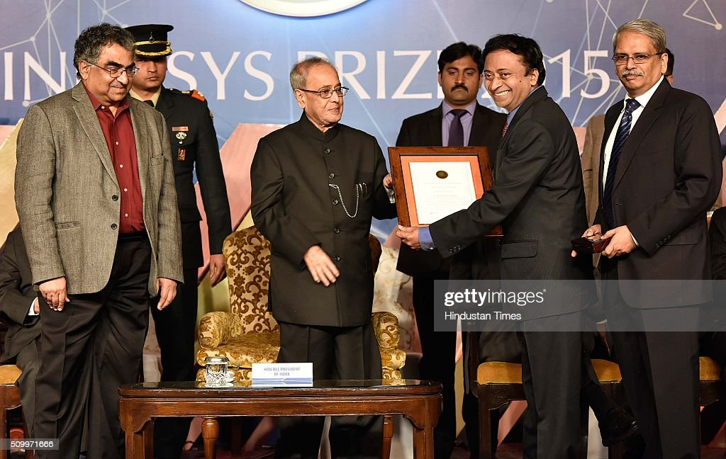 President Pranab Mukherjee presents to Prof G. Ravindra Kumar for his Work in Physical Sciences, during the Infosys Award 2015 organized by infosys Science Foundation at Taj Place on February 13, 2016 in New Delhi, India. President felicitated six winners of Infosys Science Foundation Prizes 2015 for their outstanding contribution in their fields. President awarded each laureate with a purse of Rs.65 lakh, a 22-carat gold medallion and a citation certificate.