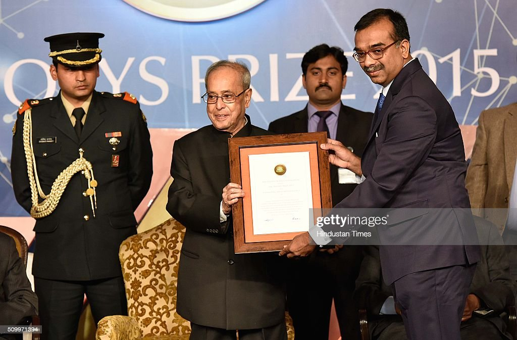 President Pranab Mukherjee presents to Prof Umesh Waghmare (Prof theoretical Sciences Unit JN centre for Advance) for his Work in engineering and computer Science, during the Infosys Award 2015 organized by infosys Science Foundation at Taj Place on February 13, 2016 in New Delhi, India. President felicitated six winners of Infosys Science Foundation Prizes 2015 for their outstanding contribution in their fields. President awarded each laureate with a purse of Rs.65 lakh, a 22-carat gold medallion and a citation certificate.