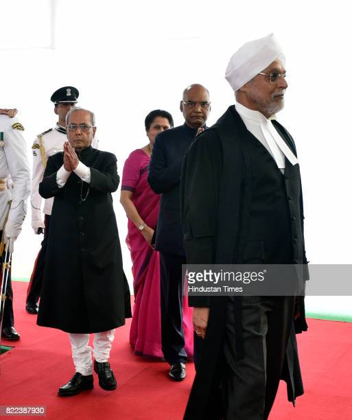 President Pranab Mukherjee Presidentelect Ram Nath Kovind and Chief Justice of India J S Khehar in a ceremonial procession at Parliament House for...