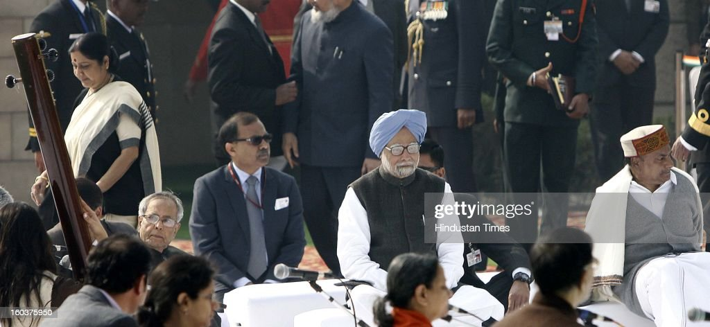President Pranab Mukherjee , Prime Minister Manmohan Singh, Defence Minister AK Antony and paying tributes to father of the nation, Mahatma Gandhi on his death anniversary, observed as Martyrs' Day, at Rajghat on January 30, 2013 in New Delhi, India.