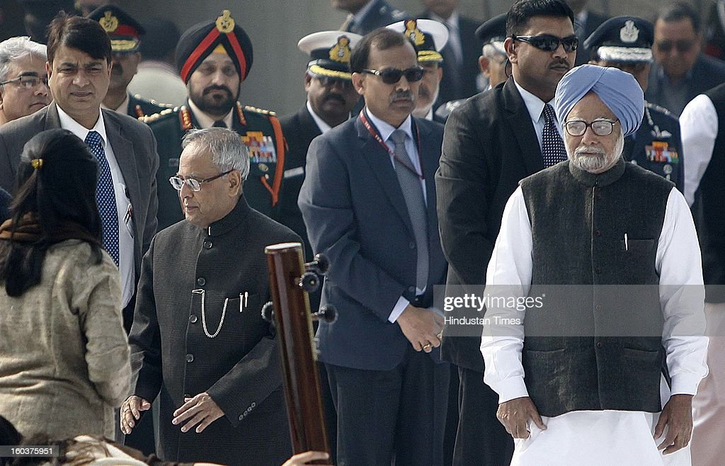 President Pranab Mukherjee , Prime Minister Manmohan Singh, paying tributes to father of the nation, Mahatma Gandhi on his death anniversary, observed as Martyrs' Day, at Rajghat on January 30, 2013 in New Delhi, India.