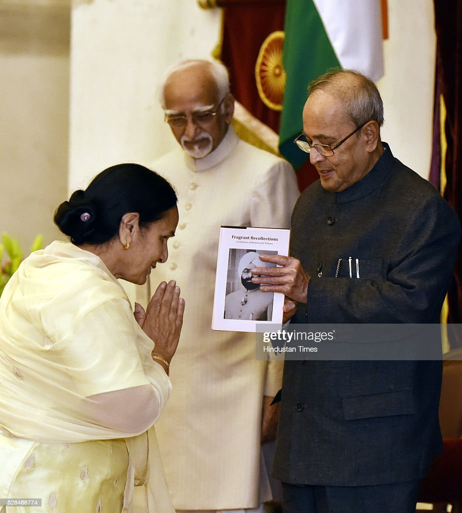 President Pranab Mukherjee recieving first copy of 'Fragrant Recollections' from Dr Gurdeep Kaur Daughter of Zail Singh as Vice President Hamid Ansari looks on during the centenary birth anniversary celebrations of former President late Gyani Zail Singh at Rashtrapati Bhavan on May 5, 2016 in New Delhi, India. Gyani Zail Singh was the seventh President of India, serving from 1982 to 1987. Prior to his presidency, he was a politician with the Indian National Congress party, and had held several ministerial posts in the Union Cabinet, including that of Home Minister.
