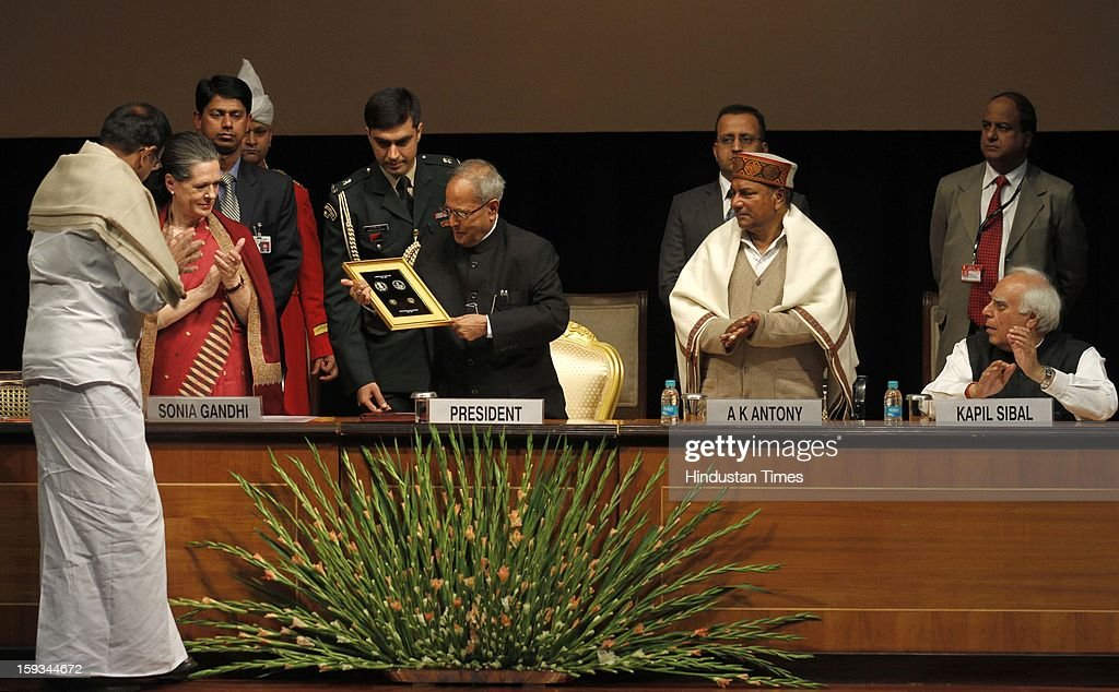 President Pranab Mukherjee (3rd R) releases the commemorative Coin during the Commemoration of 150th Birth Anniversary of Swami Vivekananda as Finance Minister P Chidambaram (L), UPA Chairman Sonia Gandhi (2nd L), Defence Minister A K Antony (2nd R) and Minister of Communications & IT Kapil Sibal (R) at Rashtrapati Bhawan on January 12, 2013 in New Delhi, India.