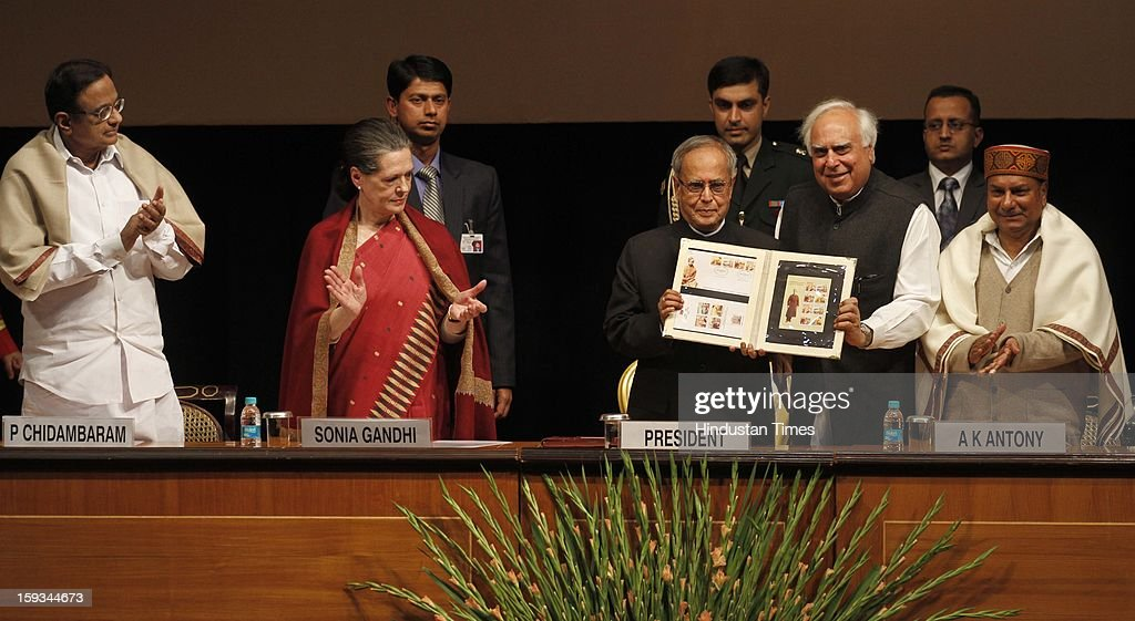 President Pranab Mukherjee (3R) releases the commemorative stamp during the Commemoration of 150th Birth Anniversary of Swami Vivekananda as Finance Minister P Chidambaram (L), UPA Chairman Sonia Gandhi (2L), Defence Minister A K Antony (R) and Minister of Communications & IT Kapil Sibal (2R)at Rashtrapati Bhawan on January 12, 2013 in New Delhi, India.