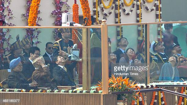 President Pranab Mukherjee takes salute as Prime Minister Manmohan Singh Vice President Hamid Ansari and chief guest Japanese Prime Minister Shinzo...