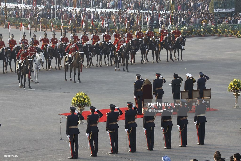 President Pranab Mukherjee takes the salute from the Presidential Guards to start the Beating Retreat ceremony at Vijay Chowk on January 29, 2013 in New Delhi, India. This ceremony officially marks the end of Republic Day celebrations.