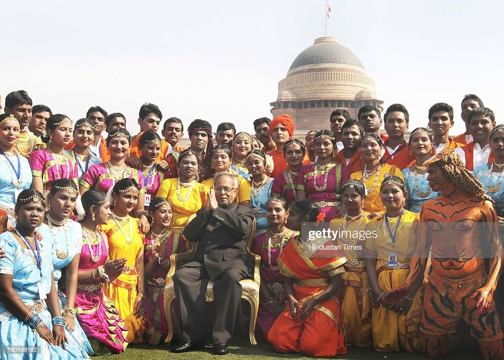 President Pranab Mukherjee with artists who participated in the Republic Day Parade-2013 at Rashtrapati Bhavan on January 27, 2013 in New Delhi, India.