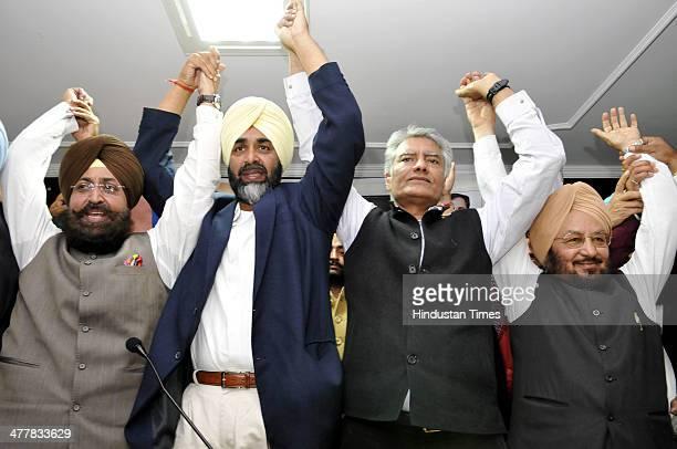 PPCC President Pratap Singh Bajwa PPP Chief Manpreet Badal CLP leader Sunil Jakhar and Senior Punjab Congress leader Lal Singh showing solidarity at...