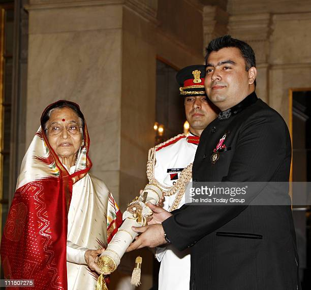 President Pratibha Devisingh Patil presenting the Padma Shri Award to shooter Gagan Narang at an Investiture Ceremony at Rashtrapati Bhavan in New...
