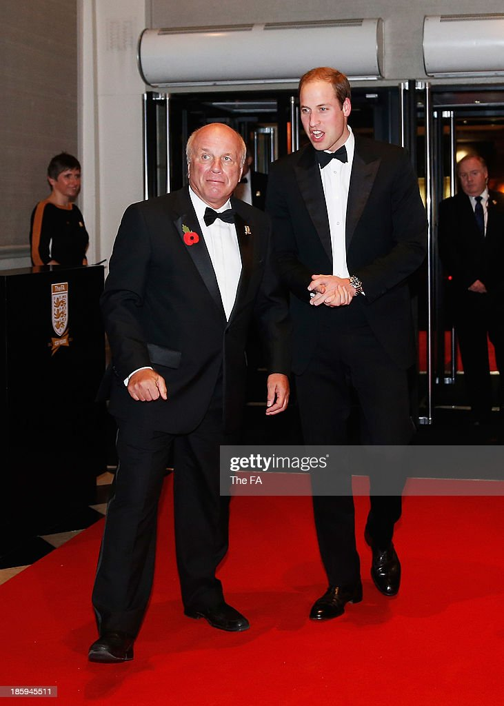 FA President Prince William, Duke of Cambridge is welcomed by <a gi-track='captionPersonalityLinkClicked' href=/galleries/search?phrase=Greg+Dyke&family=editorial&specificpeople=207080 ng-click='$event.stopPropagation()'>Greg Dyke</a>, FA Chairman as he arrives during the FA150 Gala Dinner commemorating the Football Association's 150th year at the Grand Connaught Rooms on October 26, 2013 in London, England.