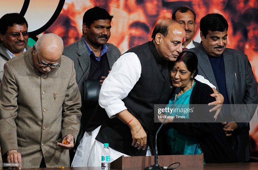 BJP President Rajnath Singh congratulated by Senior BJP Leader Sushma Swaraj while L K Advani and Former BJP President Nitin Gadkari looks on at BJP Headquarter, on January 23, 2012 in New Delhi, India. Rajnath Singh succeeds Nitin Gadkari, who decided against contesting for a second term following charges of alleged corruption.