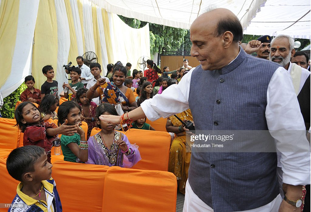 BJP President Rajnath Singh greeting the children who visited him on the occasion of Rakhi festival at his house on August 21, 2013 in New Delhi, India. Raksha Bandhan, the festival of love between brothers and sisters, is being celebrated across the country today with full enthusiasm.