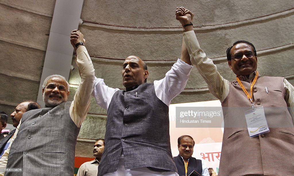 BJP President Rajnath Singh (C) is flanked by Gujarat CM Narendra Modi (L) and Madhya Pradesh CM Shivraj Singh Chauhan during the last day of the Party National Council Meeting on March 3, 2013 in New Delhi, India. Party meeting, which is aimed at strategising for the upcoming assembly and general elections as also looking at a reorganisation of the party structure.