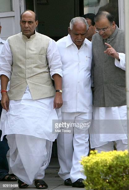 President Rajnath Singh senior BJP leder Arun Jaitley and Karnataka Chief Minister B S Yeddyurappa after a meeting at Singh's residence in New Delhi...