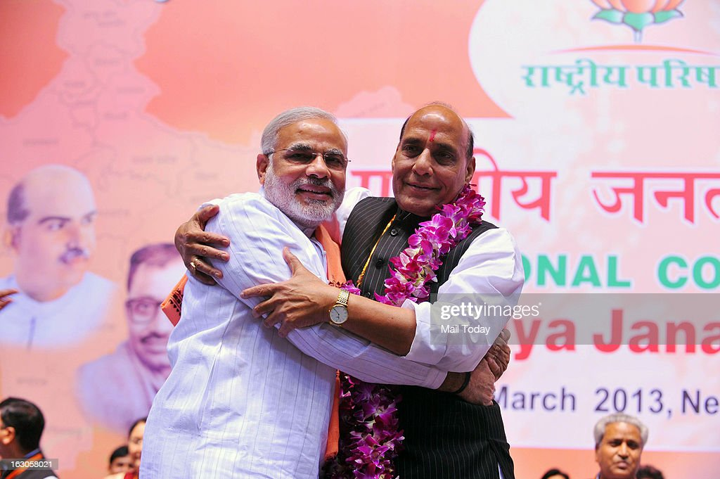 BJP President Rajnath Singh with Gujarat CM Narendra Modi during the BJP National Council meeting in New Delhi on Saturday.