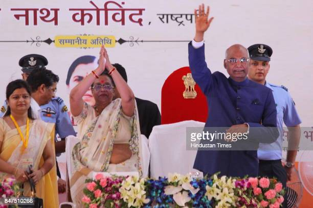 President Ram Nath Kovind and first lady Savita Kovind during the launch of Swachhta Hi Seva campaign at Iswari Ganj Village on September 15 2017 in...