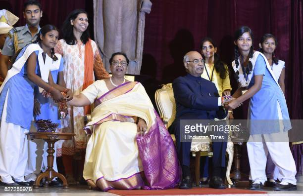 President Ram Nath Kovind and his wife Savita Kovind celebrate the festival with school students on the auspicious occasion of Raksha Bandhan at...