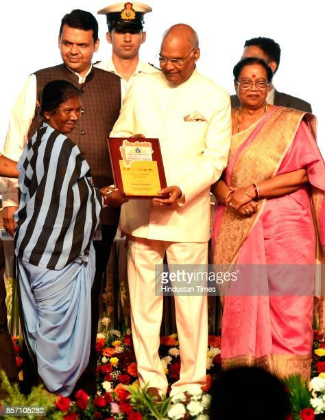 President Ram Nath Kovind awards the sanitation dept worker during an announcement of the Urban Maharashtra Open Defecation Free state in the country...