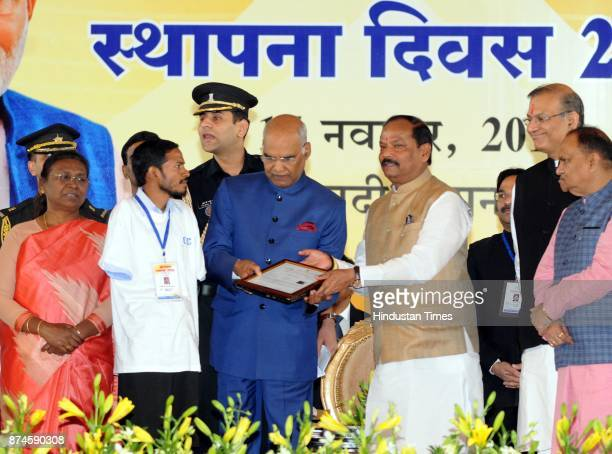 President Ram Nath Kovind giving appointed letter to a newly recruited differently abled teacher during the 17th Foundation Day function of Jharkhand...