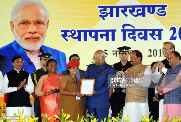 President Ram Nath Kovind giving appointment letter to a newly recruit state police constable during the 17th Foundation Day of Jharkhand state at...
