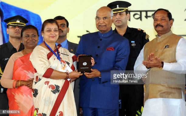 President Ram Nath Kovind giving tab to a school teacher during the 17th Foundation Day function of Jharkhand state at Morhabadi ground on November...