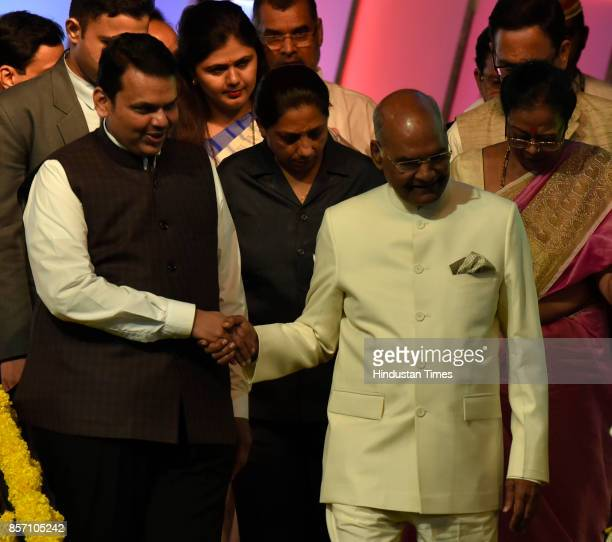 President Ram Nath Kovind interacts with Maharashtra CM Devendra Fadnavis during an announcement of the Urban Maharashtra Open Defecation Free state...