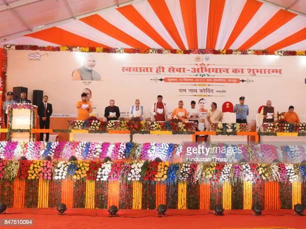 President Ram Nath Kovind makes people pledge to keep their surroundings clean during the launch of Swachhta Hi Seva campaign at Iswari Ganj Village...