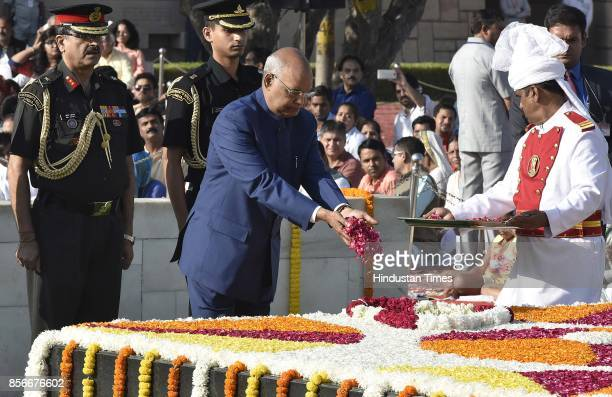 President Ram Nath Kovind pays tribute to Mahatma Gandhi on his 148th birth anniversary at Rajghat on October 2 2017 in New Delhi India Gandhi was...