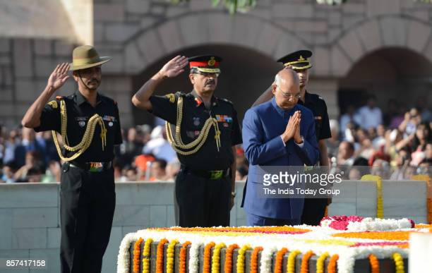 President Ram Nath Kovind pays tributes to Mahatma Gandhi the father of the nation on his 148th birth anniversary at Rajghat in New Delhi