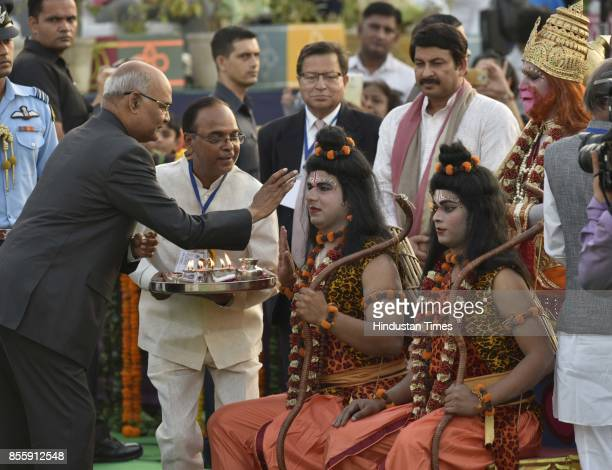 President Ram Nath Kovind performs Puja during the Dussehra festival celebration organised by Shri Dharmik Leela Committee at Lal Quila Grounds on...