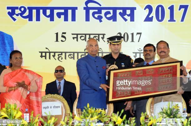 President Ram Nath Kovind recieving a momento from Chief Minister Raghubar Das while Governor Draupadi Mumru during the 17th Foundation Day function...