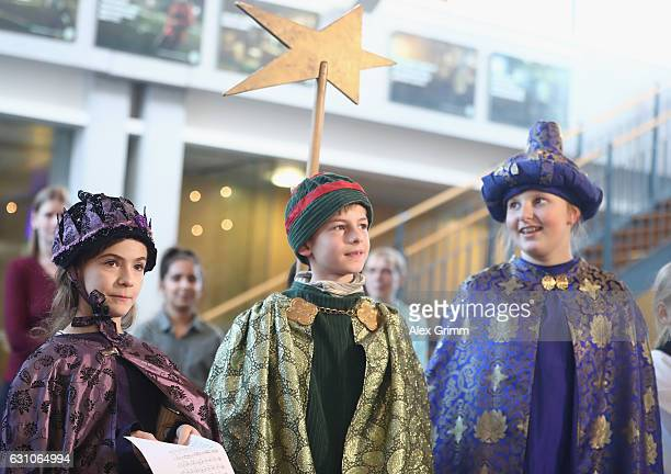 President Reinhard Grindel and General Secretary Friedrich Curtius welcome Carollers at the DFB Headquarters on January 6 2017 in Frankfurt am Main...
