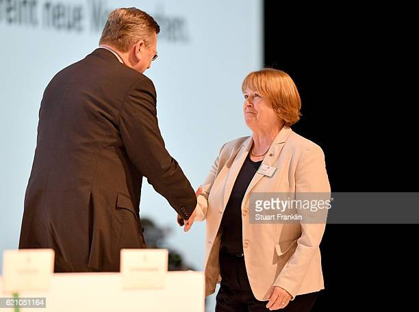 DFB president Reinhard Grindel congratulates the newly elected DFB Vice President Hannelore Ratzeburg during day 2 of the 42nd DFB Bundestag at Messe...