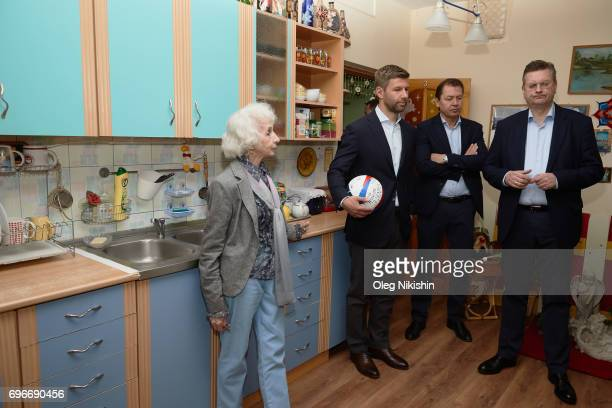 President Reinhard Grindel FB Ambassador Thomas Hizlspergers with Elizabeth Levina head of The Don Bosco Children's Home during their visit The Don...