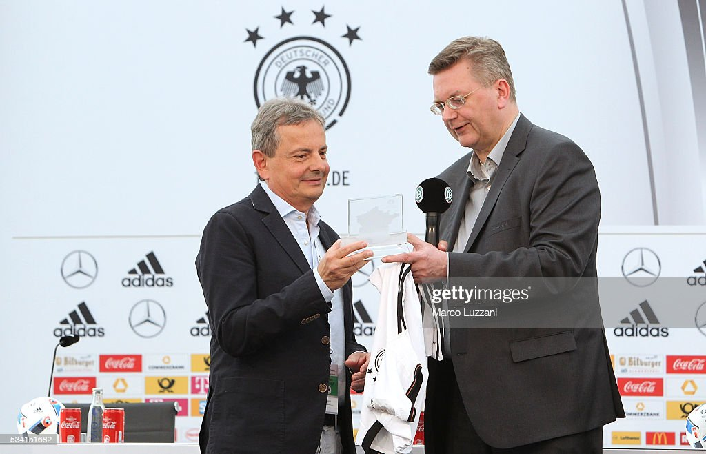 DFB president <a gi-track='captionPersonalityLinkClicked' href=/galleries/search?phrase=Reinhard+Grindel&family=editorial&specificpeople=8750586 ng-click='$event.stopPropagation()'>Reinhard Grindel</a> (R) gives a shirt to the Mayor of Ascona Luca Pissoglio (L) during the German national team's pre-EURO 2016 training camp on May 25, 2016 in Ascona, Switzerland.