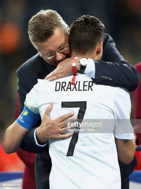 President Reinhard Grindel hugs Julian Draxler of Germany after the FIFA Confederations Cup Russia 2017 final between Chile and Germany at Saint...
