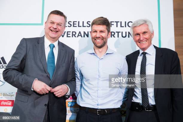 DFB President Reinhard Grindel Thomas Hitzlsperger and Eugen Gehlenborg attend a DFB Press Conference to announce Thomas Hitzlsperger as new...