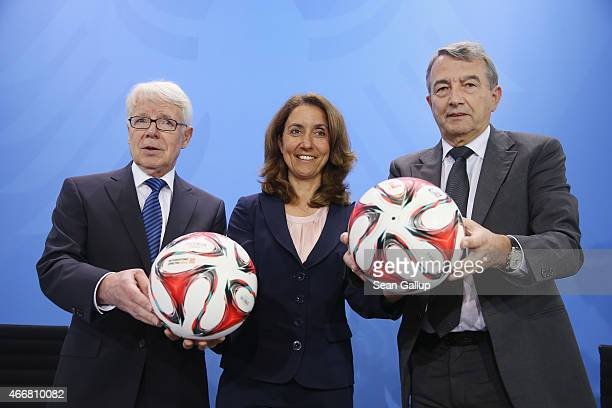 DFL President Reinhard Rauball German Integration Commissioner Aydan Ozoguz and DFB President Wolfgang Niersbach hold soccer balls as they arrive for...